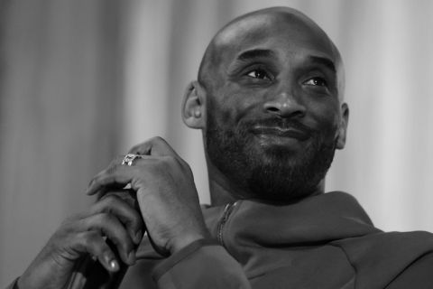Former Los Angeles Lakers NBA basketball player Kobe Bryant listens to a question as he meets with students at Andrew Hamilton School in Philadelphia, Thursday, March 21, 2019. Kobe Bryant was promoting the book The Wizenard Series: Training Camp he created with writer Wesley King. (AP Photo/Matt Rourke)