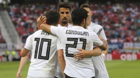 Germany's Mesut Ozil, left, celebrates with his teammates after scoring the opening goal during a friendly soccer match between Austria and Germany in Klagenfurt, Austria, Saturday, June 2, 2018. (AP Photo/Ronald Zak)