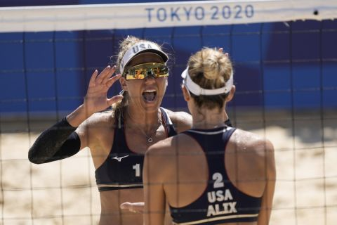 April Ross, left, of the United States, and teammate Alix Klineman celebrate winning a women's beach volleyball semifinal match against Switzerland at the 2020 Summer Olympics, Thursday, Aug. 5, 2021, in Tokyo, Japan. (AP Photo/Petros Giannakouris)