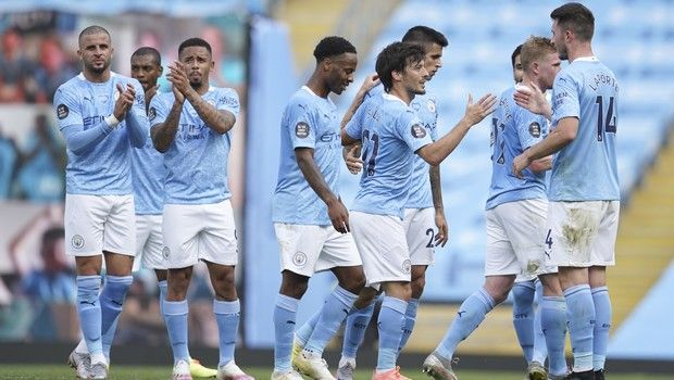 Manchester City's David Silva is applauded by team mates at the end of the English Premier League soccer match between Manchester City and Norwich City at the Etihad Stadium in Manchester, England, Sunday, July 26, 2020. (AP Photo/Dave Thompson, Pool)