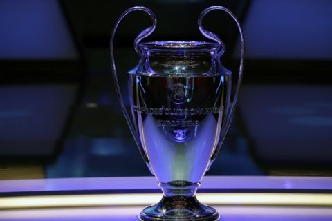 The Champions League trophy is displayed before the UEFA group stage draw at the Grimaldi Forum, in Monaco, Thursday, Aug. 29, 2019. (AP Photo/Daniel Cole)