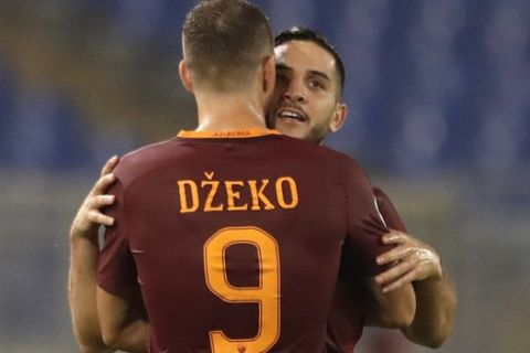 Romas Kostas Manolas, right, celebrates with teammate Edin Dzeko after scoring, during a Serie A soccer match between Roma and Inter Milan, at Rome's Olympic Stadium, Sunday, Oct. 2, 2016. (AP Photo/Andrew Medichini)
