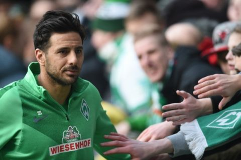 FILE - In this Feb. 27, 2016 file picture, Bremen's Claudio Pizarro  cheers with fans after the German Bundesliga football match between Werder Bremen and SV Darmstadt at the Weserstadion in Bremen, Germany, Werder Bremen striker Claudio Pizarro will miss Saturday's Bundesliga match against Bayern Munich because of a groin injury. Werder said Friday March 11, 2016  that Pizarro will not travel to Munich to face his former team after getting injured in training.  ( Carmen Jaspersen/dpa via AP,file)