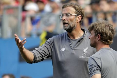 Liverpool manager Jurgen Klopp directs his team against Borussia Dortmund during the second half of an International Champions Cup tournament soccer match in Charlotte, N.C., Sunday, July 22, 2018. (AP Photo/Chuck Burton)