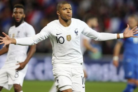 France's Kylian Mbappe celebrates after scoring a goal during a friendly soccer match between France and Iceland, in Guingamp, western France, Thursday, Oct. 11, 2018. (AP Photo/David Vincent)