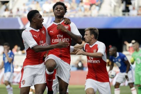 Arsenal forward Chuba Akpom, center, celebrates his goal with teammate Alex Iwobi, left, during the second half of the MLS All-Star soccer game against the MLS All-Stars on Thursday, July 28, 2016, in San Jose, Calif. Arsenal won 2-1. (AP Photo/Marcio Jose Sanchez)