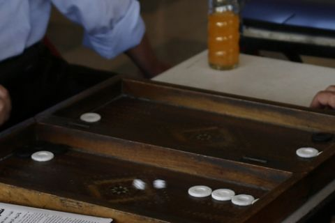 Syrians play backgammon and smoke water pipes at a coffee shop, in Damascus, Syria, Sunday, Aug. 25, 2013. Syria reached an agreement with the United Nations on Sunday to allow a U.N. team of experts to visit the site of alleged chemical weapons attacks last week outside Damascus, state media said. (AP Photo/Hassan Ammar)