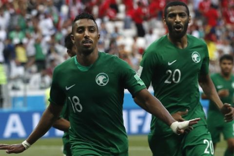 Saudi Arabia's Salem Aldawsari celebrates after scoring his side's second goal during the group A match between Saudi Arabia and Egypt at the 2018 soccer World Cup at the Volgograd Arena in Volgograd, Russia, Monday, June 25, 2018. (AP Photo/Darko Vojinovic)