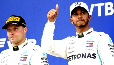 Mercedes driver Valtteri Bottas of Finland, left, and Mercedes driver Lewis Hamilton of Britain celebrate after the Russian Formula One Grand Prix at the Sochi Autodrom circuit in Sochi, Russia, Sunday, Sept. 30, 2018.(AP Photo/Sergei Grits)
