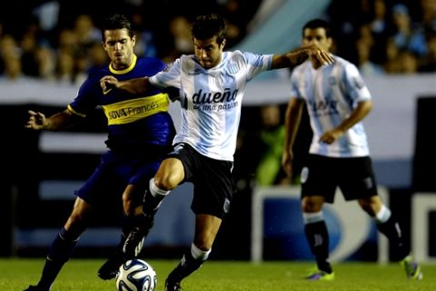 Boca Juniors' Fernando Gago, left, fights for the ball with Racing Club's Francisco Cerro during an Argentine league soccer match in Buenos Aires, Argentina, Sunday, March 9, 2014. (AP Photo/Natacha Pisarenko)