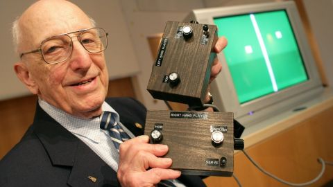 German-American game developer Ralph Baer shows the prototype of the first games console which was invented by him during a press conference on the Games Convention Online in Leipzig, Germany in 2009. Baer died on Saturday. He was 92.
