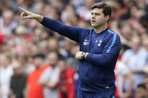 Tottenham manager Mauricio Pochettino gestures during the English FA Cup semifinal soccer match between Manchester United and Tottenham Hotspur at Wembley stadium in London, Saturday, April 21, 2018. (AP Photo/Kirsty Wigglesworth)