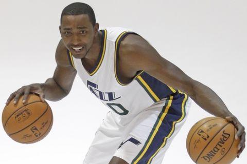 In this Monday, Sept. 29, 2014, photo, Utah Jazz forward Jeremy Evans (40) poses for a photo during NBA basketball media day, in Salt Lake City. (AP Photo/Rick Bowmer)