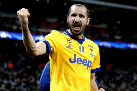 Juventus' Giorgio Chiellini celebrates at the end of a the Champions League, round of 16, second-leg soccer match between Juventus and Tottenham Hotspur, at the Wembley Stadium in London, Wednesday, March 7, 2018. Juventus won 2-1. (AP Photo/Frank Augstein)