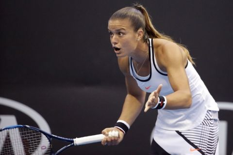Greece's Maria Sakkari gestures while playing France's Alize Cornet during their second round match at the Australian Open tennis championships in Melbourne, Australia, Thursday, Jan. 19, 2017. (AP Photo/Dita Alangkara)