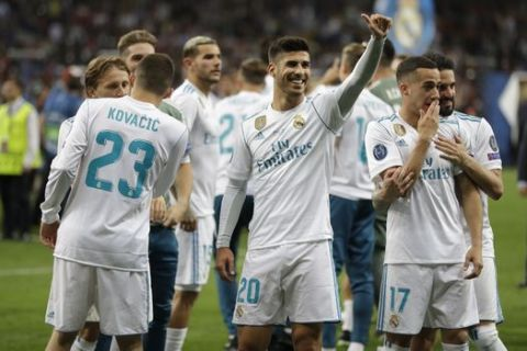 Real Madrid teammates celebrate after winning the Champions League Final soccer match between Real Madrid and Liverpool at the Olimpiyskiy Stadium in Kiev, Ukraine, Saturday, May 26, 2018. (AP Photo/Sergei Grits)