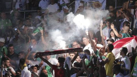 Algerian fans cheer during the African Cup of Nations group C soccer match between Algeria and Kenya at 30 June Stadium in Cairo, Egypt, Sunday, June 23, 2019. (AP Photo/Hassan Ammar)
