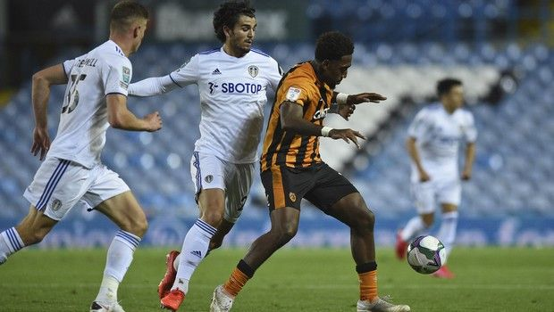 Hulls' Mallik Wilks, right controls the ball during the English League Cup soccer match between Leeds United and Hull in Leeds, England, Wednesday, Sept. 16, 2020. (Oli Scarf/Pool via AP)