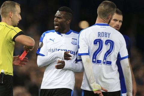 Apollon Limassol's Valentin Roberge, right, is shown a red card during the game against Everton, during the Europa League, Group E soccer match at Goodison Park, Liverpool, England, Thursday Sept. 28, 2017. (Peter Byrne/PA via AP)