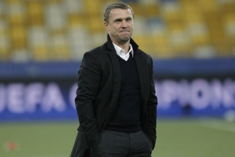 Dynamo Kiev's team coach Serhiy Rebrov grimaces as he stands on the field before the Champions League Group B soccer match between Dynamo Kiev and Benfica at the Olympiyskiy national stadium in Kiev, Ukraine, Wednesday, Oct. 19, 2016. (AP Photo/Sergei Chuzavkov)