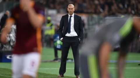 Real Madrid's French coach Zinedine Zidane looks on during the UEFA Champions League football match AS Roma vs Real Madrid on Frebruary 17, 2016 at the Olympic stadium in Rome.   AFP PHOTO / ALBERTO PIZZOLI / AFP / ALBERTO PIZZOLI        (Photo credit should read ALBERTO PIZZOLI/AFP/Getty Images)