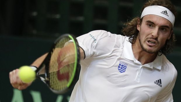 Stefanos Tsitsipas of Greece returns the ball to Alberto Lim of the Philippines during their Davis Cup World Group II play-offs first round singles match in Manila, Philippines on Friday, March 6, 2020. Tsitsipas won 6-2, 6-1. (AP Photo/Aaron Favila)