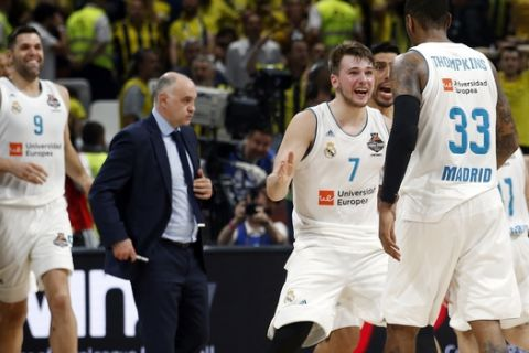 Real Madrid's Luka Doncic reacts with Real Madrid's Trey Thompkins after winning their Final Four Euroleague final basketball match against Fenerbahce in Belgrade, Serbia, Sunday, May 20, 2018. (AP Photo/Darko Vojinovic)