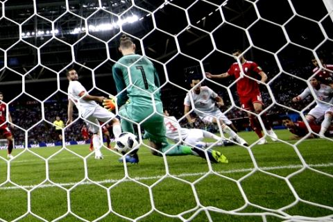 Iran's Saeid Ezatolahi scores past Spain goalkeeper David De Gea a goal that was later disallowed during the group B match between Iran and Spain at the 2018 soccer World Cup in the Kazan Arena in Kazan, Russia, Wednesday, June 20, 2018. (AP Photo/Sergei Grits)