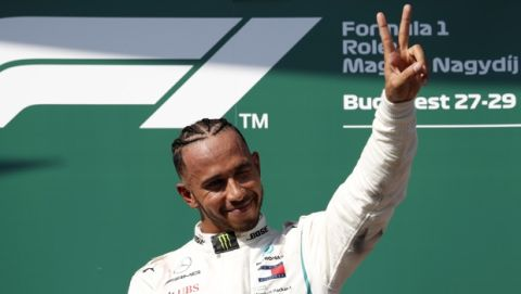 Mercedes driver Lewis Hamilton of Britain gestures after winning the Hungarian Formula One Grand Prix, at the Hungaroring racetrack in Mogyorod, northeast of Budapest, Sunday, July 29, 2018. (AP Photo/Laszlo Balogh)