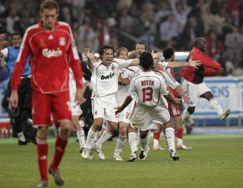 Liverpool's Peter Crouch walks off as AC Milan players celebrate after they beat Liverpool 2-1 in the Champions League Final soccer match between AC Milan and Liverpool at the Olympic Stadium in Athens Wednesday May 23, 2007. (AP Photo/Ivan Sekretarev)