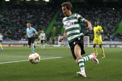Sporting's Fabio Coentrao runs with the ball during the Europa League round of 32 second leg soccer match between Sporting CP and Astana at the Alvalade stadium in Lisbon, Thursday Feb. 22, 2018. (AP Photo/Armando Franca)