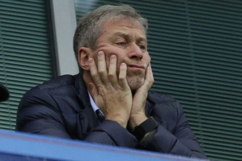 FILE - In this file photo dated Saturday, Dec. 19, 2015, Chelsea soccer club owner Roman Abramovich sits in his box before the English Premier League soccer match between Chelsea and Sunderland at Stamford Bridge stadium in London. (AP Photo/Matt Dunham, File)
