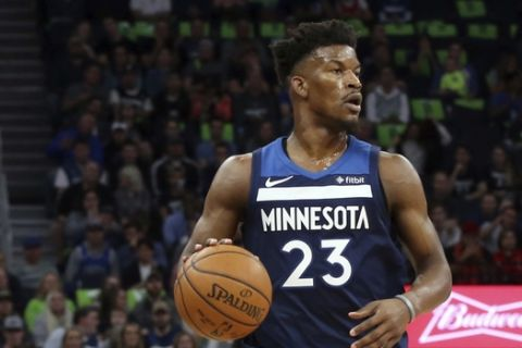 Minnesota Timberwolves' Jimmy Butler plays against the Houston Rockets during the first half of Game 4 in an NBA basketball first-round playoff series Monday, April 23, 2018, in Minneapolis. (AP Photo/Jim Mone)