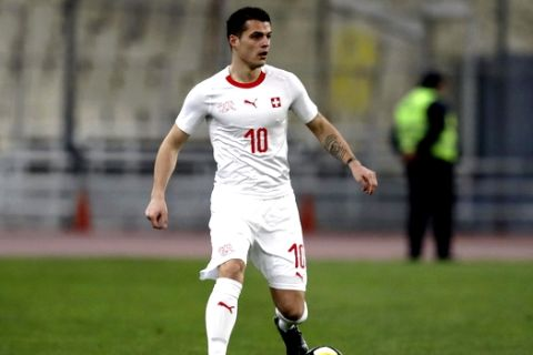 Switzerland's Granit Xhaka controls the ball during an international friendly soccer match against Greece at the Olympic stadium in Athens, Friday, March 23, 2018. (AP Photo/Thanassis Stavrakis)