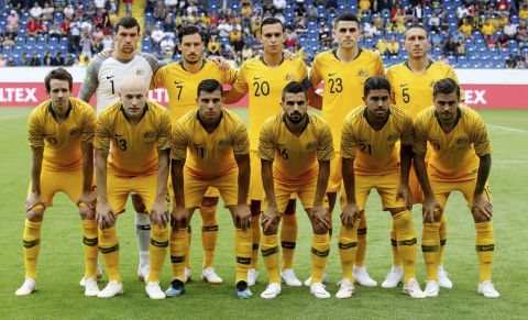 Australia's soccer team first raw from left, Robbie Kruse, Aaron Mooy, Andrew Nabbout, Aziz Behich, Massimo Luongo, Joshua Risdon, second raw from left, Matthew Ryan, Mathew Leckie, Trent Sainsbury, Tomas Rogic and Mark Milligan during a friendly soccer match between Australia and Czech Republic in St Poelten, Austria, Friday, June 1, 2018. (AP Photo/Ronald Zak)