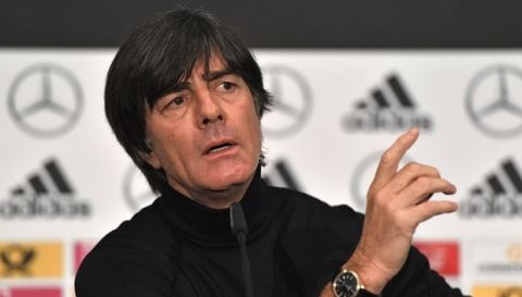 FILE - In this Monday, Nov. 13, 2017 filer, Germany's head coach Joachim Loew talks to the media at a press conference prior to the international friendly soccer match between Germany and France in Cologne, Germany. (AP Photo/Martin Meissner, File )