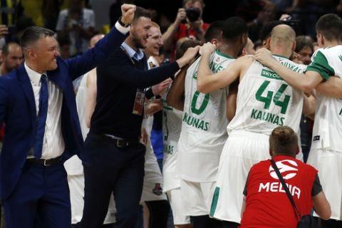 Zalgiris players celebrate after winning at Final Four Euroleague third place basketball match between CSKA Moscow and Zalgiris Kaunas in Belgrade, Serbia, Sunday, May 20, 2018. (AP Photo/Darko Vojinovic)