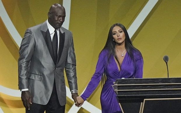 Presenter Michael Jordan, left, holds the hand of Vanessa Bryant, widow of Kobe Bryant, after Kobe Bryant was enshrined with the 2020 Basketball Hall of Fame class Saturday, May 15, 2021, in Uncasville, Conn.