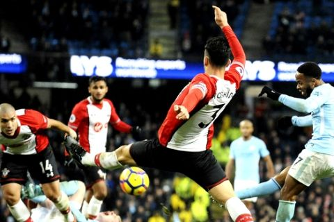 Manchester City's Raheem Sterling, right, scores his side second goal during the English Premier League soccer match between Manchester City and Southampton at Etihad stadium, in Manchester, England, Wednesday, Nov. 29, 2017. (AP Photo/Rui Vieira)