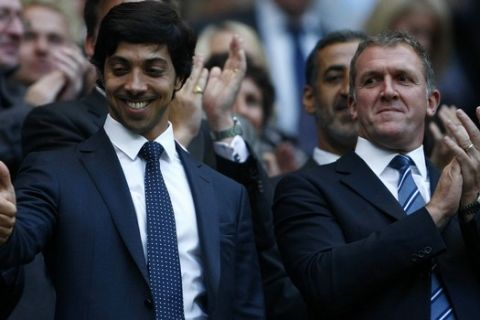 Manchester City owner Sheikh Mansour reacts before the English Premier League soccer match between Manchester City and Liverpool at the City of Manchester Stadium, Manchester, England, Monday Aug. 23, 2010. (AP Photo/Tim Hales) ** NO INTERNET/MOBILE USAGE WITHOUT FOOTBALL ASSOCIATION PREMIER LEAGUE (FAPL) LICENCE. CALL +44 (0) 20 7864 9121 or EMAIL info@football-dataco.com FOR DETAILS **