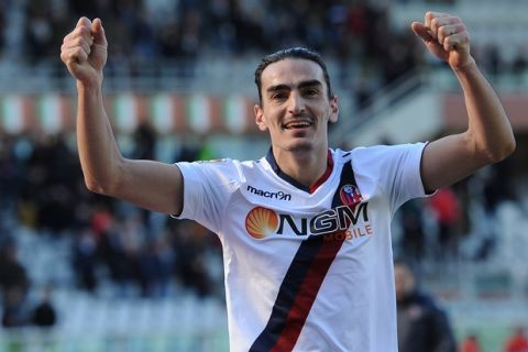 TURIN, ITALY - FEBRUARY 09:  Lazaros Christodoulopoulos of Bologna FC celebrates victory at the end of the Serie A match between Torino FC and Bologna FC at Stadio Olimpico di Torino on February 9, 2014 in Turin, Italy.  (Photo by Valerio Pennicino/Getty Images)