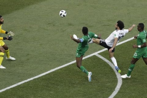 Egypt's Mohamed Salah scores the opening goal during the group A match between Saudi Arabia and Egypt at the 2018 soccer World Cup at the Volgograd Arena in Volgograd, Russia, Monday, June 25, 2018. (AP Photo/Themba Hadebe)