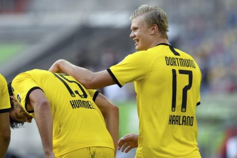 Dortmund's Erling Haaland, right, celebrates after scoring the opening goal during the German Bundesliga soccer match between Fortuna Duesseldorf and Borussia Dortmund in Duesseldorf, Germany, Saturday, June 13, 2020. Because of the coronavirus outbreak all soccer matches of the German Bundesliga take place without spectators. (Bernd Thissen/Pool via AP)