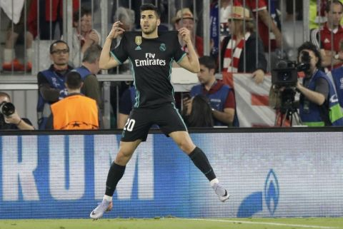 Real Madrid's Marco Asensio celebrates after scoring his side's second goal during the semifinal first leg soccer match between FC Bayern Munich and Real Madrid at the Allianz Arena stadium in Munich, Germany, Wednesday, April 25, 2018. (AP Photo/Matthias Schrader)