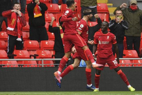 Liverpool's Sadio Mane, right, celebrates scoring his sides first goal during the English Premier League soccer match between Liverpool and Crystal Palace at Anfield stadium in Liverpool, England, Sunday, May 23, 2021. (Paul Ellis/Pool via AP)