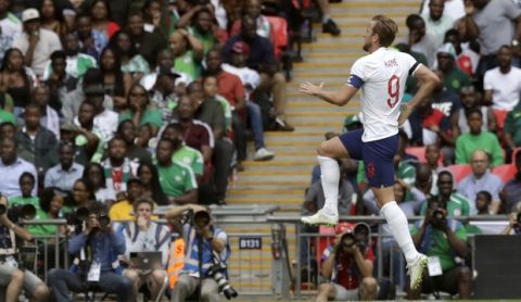 England's Harry Kane celebrates after scoring his side's second goal during a friendly soccer match between England and Nigeria at Wembley stadium in London, Saturday, June 2, 2018. (AP Photo/Matt Dunham)