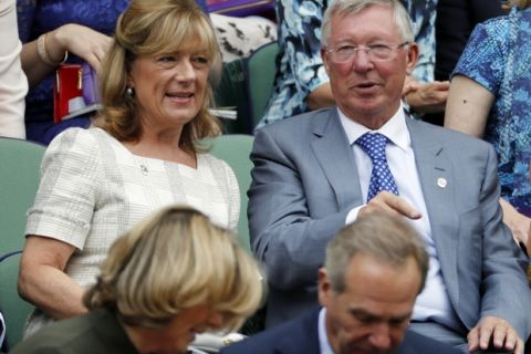 Former football manager Sir Alex Ferguson, right, sits in the Royal Box on day twelve of the Wimbledon Tennis Championships in London, Friday, July 8, 2016. (AP Photo/Ben Curtis)