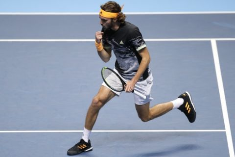 Stefanos Tsitsipas of Greece celebrates winning a point against Daniil Medvedev of Russia during their ATP World Tour Finals singles tennis match at the O2 Arena in London, Monday, Nov. 11, 2019. (AP Photo/Kirsty Wigglesworth)