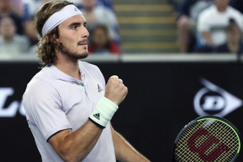 Stefanos Tsitsipas of Greece reacts after winning a point against Italy's Salvatore Caruso during their first round singles match the Australian Open tennis championship in Melbourne, Australia, Monday, Jan. 20, 2020. (AP Photo/Dita Alangkara)