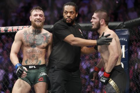 FILE - In this Oct. 6, 2018, file photo, Conor McGregor, left, fights Khabib Nurmagomedov are separated during a UFC 229 mixed martial arts bout in Las Vegas. Nurmagomedov was fined $500,000 and suspended for nine months for a brawl inside and outside the octagon after his fight with Conor McGregor at UFC 229. McGregor was fined $50,000 and suspended for six months.  The suspensions for both fighters are retroactive to Oct. 6. (AP Photo/John Locher, File)